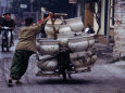 Man Transporting Locally Made Ceramic Pots by Bicycle, Hanoi, Vietnam