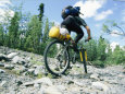 Bikers Travel Across the Rough Terrain and Melt Ice of Southern Alaska
